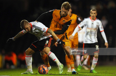 Konstantinos Stafylidis of Fulham battles with James Henry of Wolverhampton Wanderers during the FA Cup Third Round match between Fulham and Wolverhampton Wanderers at Craven Cottage on January 3, 2015 in London, England. (Photo by Bryn Lennon/Getty Images)