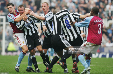 Gareth Barry of Aston Villa pulls apart Newcastle's Lee Bowyer and Kieron Dyer as they come to blows during the FA Barclays Premiership match between Newcastle United and Aston Villa at St James Park on April 2, 2005 in Newcastle, England. (Photo by Laurence Griffiths/Getty Images)