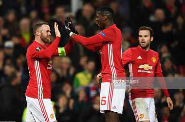 Wayne Rooney (left) says Paul Pogba (cente) should stay at Manchester United but it is his call&nbsp;<div>(Gareth Copley/Getty Images)</div>