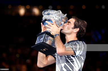 Federer embraces his 18th Grand Slam trophy at the Australian Open in 2017 (Photo credit- Cameron Spencer)
