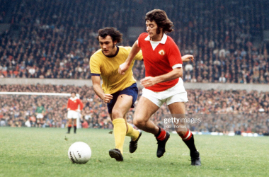 Football, 26th October, 1972, Manchester United's Willie Morgan on the ball chased by Arsenal's Ray Kennedy during their league match at Old Trafford (Photo by Bob Thomas Sports Photography via Getty Images)