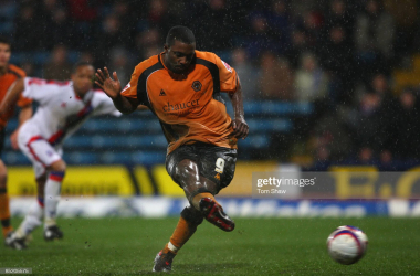 Sylvan Ebanks-Blake tucks away the match-winning penalty at Selhurst Park 12 years ago today. (Photo by Tom Shaw/Getty Images)