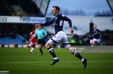 Jed Wallace of Millwall celebrates scoring his sides first goal during the Sky Bet Championship match between Millwall and Middlesbrough at The Den on December 16, 2017. (Photo by Jordan Mansfield/Getty Images)