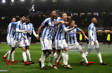 Huddersfield celebrate in their 4-1 win at Vicarage Road last season | Photo via Getty Images/ Christopher Lee