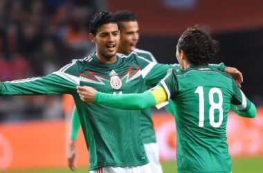 Vela and Guardado celebrate a goal. They look to do much of that in this Gold Cup. (Photo Credit: AP)