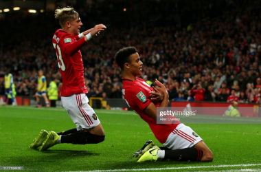 MANCHESTER, ENGLAND - SEPTEMBER 25: Mason Greenwood of Manchester United celebrates scoring his teams first goal of the game with team mate Brandon Williams during the Carabao Cup Third Round match between Manchester United and Rochdale AFC at Old Trafford on September 25, 2019 in Manchester, England. (Photo by Alex Livesey/Getty Images)