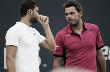Grigor Dimitrov (L) and Stan Wawrinka discuss strategy during their second round doubles match against Henri Kontinen and John Peers at the 2016 Rogers Cup. | Photo: Max Gao