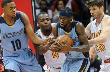 Grizzlies' Briante Weber guards the ball from Hawk's Paul Millsap and Kyle Korver. John Amis | AP Photo