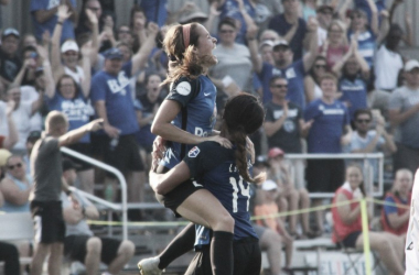 Goal celebrations like this one between Shea Groom and Sydney Leroux are now a thing of the past for Kansas City women's soccer fans. | Source: Emily Kesel - VAVEL USA