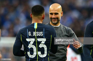 Pep Guardiola(right) smiling and chatting with match-winner Gabriel Jesus(left) after their FA Cup Semi-Final win. Image courtesy of Craig Mercer from MB Media on Getty Images.