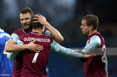 BURNLEY, ENGLAND - FEBRUARY 06: Johann Gudmundsson of Burnley celebrates with teammates Erik Pieters and Matej Vydra after scoring their team's first goal during the Premier League match between Burnley and Brighton & Hove Albion at Turf Moor on February 06, 2021 in Burnley, England. Sporting stadiums around the UK remain under strict restrictions due to the Coronavirus Pandemic as Government social distancing laws prohibit fans inside venues resulting in games being played behind closed doors. (Photo by Clive Brunskill/Getty Images)