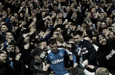 Halliday mobbed by Rangers supporters.