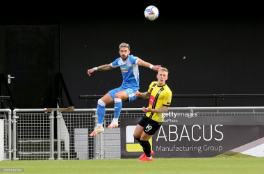 Barrow's Calvin Miller takes on Harrogate Town's Bradley Barry during the reverse fixture at Wetherby Road | (Photo by Mark Fletcher/MI News/NurPhoto via Getty Images)