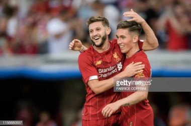 Harry Wilson celebrating his goal in pre-season against Lyon with Adam Lallana | Photo: Fabrice Coffrini/Gerry Images