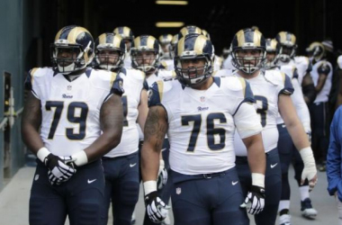 The St. Louis Rams offensive linemen head out of the tunnel before a game in 2014. Photo courtesy of John Froschauer.