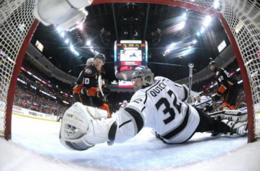 Jonathan Quick (32, white) has frustrated Corey Perry (10, black) and the Anaheim Ducks with his stellar goal tending through the first two games of the series.