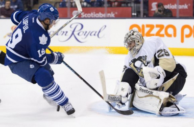 The Maple Leafs' Joffrey Lupul is stopped in close by Penguins goalie Marc-Andre Fleury.www.sports.nationalpost.com