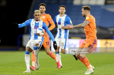 Huddersfield Town's Juninho Bacuna vies for possession with Cardiff City's Joe Ralls. Photo: Rich Linley/CameraSport/Getty Images.