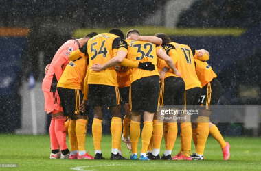 WEST BROMWICH, ENGLAND - MAY 03: Players of Wolverhampton Wanderers form a huddle prior to the Premier League match between West Bromwich Albion and Wolverhampton Wanderers at The Hawthorns on May 03, 2021 in West Bromwich, England. Sporting stadiums around the UK remain under strict restrictions due to the Coronavirus Pandemic as Government social distancing laws prohibit fans inside venues resulting in games being played behind closed doors. (Photo by Shaun Botterill/Getty Images)