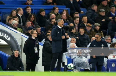 Chris Hughton in the dugout at Stamford Bridge last night. Image courtesy of John Patrick Fletcher on Getty images.