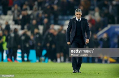 Chris Hughton walking across the pitch after Brighton's defeat to Leicester, Image courtesy of Malcolm Couzens on Getty Images.