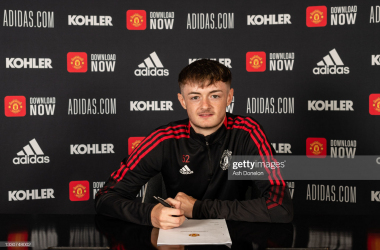 MANCHESTER, ENGLAND - JULY 26: Joe Hugill of Manchester United poses after signing a contract extension at Carrington Training Ground on July 26, 2021 in Manchester, England. (Photo by Ash Donelon/Manchester United via Getty Images)