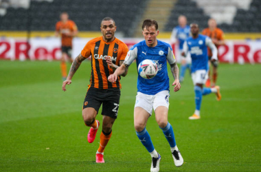 <div>&nbsp;Peterborough United's Frankie Kent shields the ball from Hull City's Josh Magennis during the Sky Bet League One match between Hull City and Peterborough United at KCOM Stadium on October 24, 2020 in Hull, England. (Photo by Alex Dodd - CameraSport via Getty Images)</div><div><br></div>
