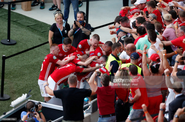 Attila Fiola of Hungary (obscured) celebrates with the fans after scoring their side's first goal during the UEFA Euro 2020 Championship Group F match between Hungary and France at Puskas Arena on June 19, 2021 in Budapest, Hungary. (Photo by Laszlo Balogh - Pool/Getty Images)