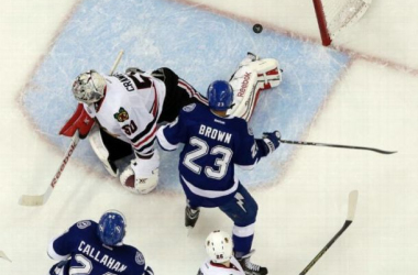 J.T. Brown and Ryan Callahan watch as Cedric Paquette scores the opening goal of game two. Photo by Chris O'Meara, AP.