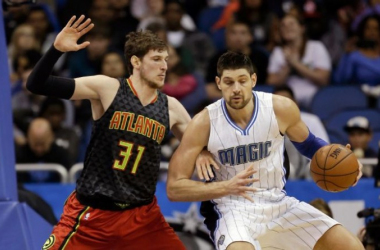 Orlando Magic center Nikola Vucevic, right, looks for a way to the basket around Atlanta Hawks forward Mike Muscala (31) during the second half of an NBA basketball game, Sunday, Feb. 7, 2016, in Orlando, Fla. (AP Photo/John Raoux)