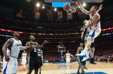 Los Angeles Clippers Blake Griffin dunks against San Antonio Spurs Aron Baynes during the second half of Game 1 of a first-round NBA basketball playoff series in Los Angeles, Sunday, April 19, 2015. (Ed Crisostomo/The Orange County Register via AP)