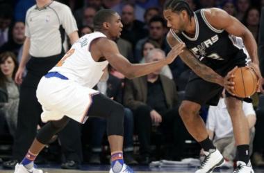 Kawhi Leonard of the San Antonio Spurs sizes up the Knicks' Langston Galloway in San Antonio's 10 point win in New York (AP Photo/Frank Franklin II)