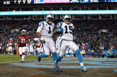 Cam Newton #1 of the Carolina Panthers celebrates as Ted Ginn Jr. #19 scores a touchdown in the first quarter against the Arizona Cardinals during the NFC Championship Game at Bank of America Stadium on January 24, 2016 in Charlotte, North Carol