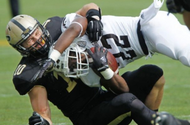 Lineback Sean Robinson makes a tackle for Purdue (John Terhune/Journal & Courier / AP Photo)