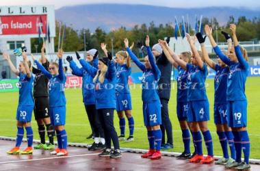 Iceland end the qualifiers with their now legendary 'Viking Clap', something the Scotland players joined in with. Photo: Tommy Hughes