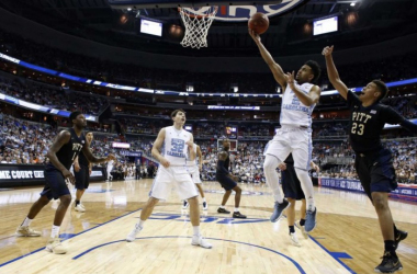 Joel Berry (2) finds a lane around Cameron Johnson's (23) defense for an easy lay-up. (AP Photo/Alex Brandon)