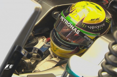 Sporting the familiar Yello helmet, in trbiute to Ayrton Senna, Lewis Hamilton looked in good form in FP1. (Image Credit: Formula One)