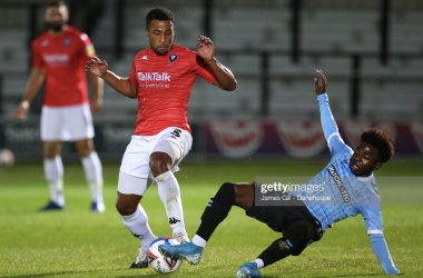 SALFORD, ENGLAND - OCTOBER 20: Ibou Touray of Salford City is tackled by Terrell Egbri of Southend United during the Sky Bet League Two match between Salford City and Southend United at Moor Lane on October 20, 2020 in Salford, England. (Photo by James Gill - Danehouse/Getty Images)