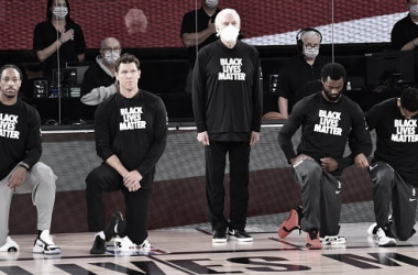 San Antonio Coaches Stand For The Anthem