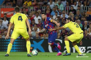 Pau y Albiol intentando frenar a Leo Messi / Foto: LaLiga