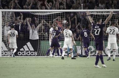 Chris Schuler and Chris Mueller embrace after the opening goal against Toronto | Source: MLS Soccer