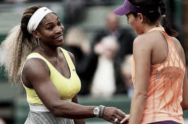 Williams congratulates Muguruza at the net after the Spaniard beat her at the French Open in 2014. Photo source: CBS