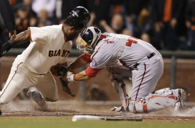 Sandoval tagged out after being waved home. (AP Photo/Ben Margot)