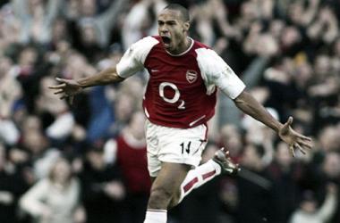 Thierry Henry celebrates scoring against Tottenham.