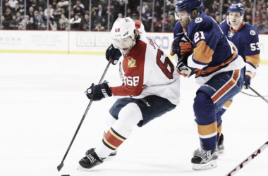 Jaromir Jagr #68 of the Florida Panthers skates against Kyle Okposo #21 of the New York Islanders at the Barclays Center on March 14, 2016 in the Brooklyn borough of New York City. The Islanders defeated the Panthers 3-2.(March 13, 2016 - Source