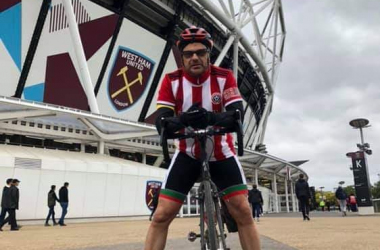 Meet the Sheffield United fan cycling to every Premier League away game for charity