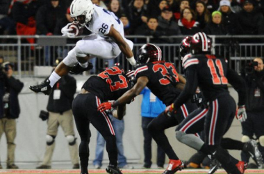 Penn State running back Saquon Barkley (26) hurdles over Ohio State Buckeyes safety Tyvis Powell (23) as linebacker Dante Booker (33) and safety Vonn Bell (11) defend in the second quarter on Oct. 17, 2015, at Ohio Stadium. (James Lang | USA TODAY Sports)