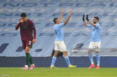 Gabriel Jesus of Manchester City celebrates with team mate Riyad Mahrez after scoring their side's fourth goal during the Premier League match between Manchester City and Wolverhampton Wanderers at Etihad Stadium on March 02, 2021 in Manchester, England. Sporting stadiums around the UK remain under strict restrictions due to the Coronavirus Pandemic as Government social distancing laws prohibit fans inside venues resulting in games being played behind closed doors. (Photo by Paul Ellis - Pool/Getty Images)