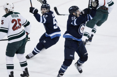 Winnipeg Jets celebrate their advancement to the next round. (Photo: John Woods/Canadian Press)