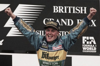 Benetton's Johnny Herbert celebrating his first ever Formula One win.